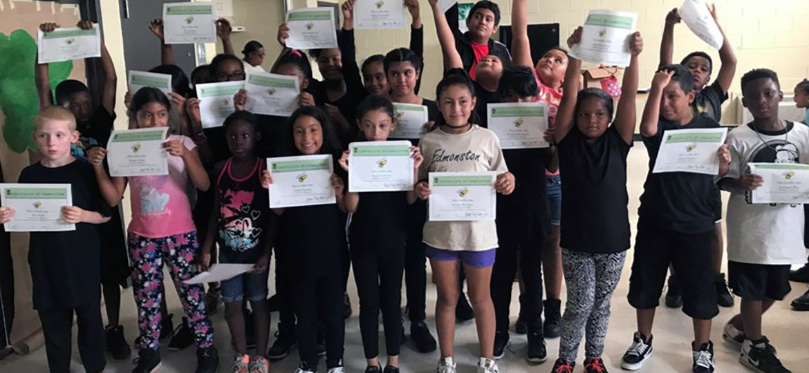 kids holding camp certificates