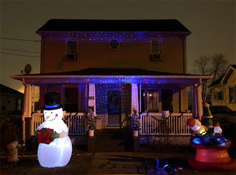 house with santa and lights