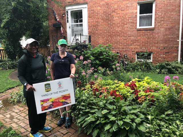 Council Member Hilary Chester presented the Yard of the Month award